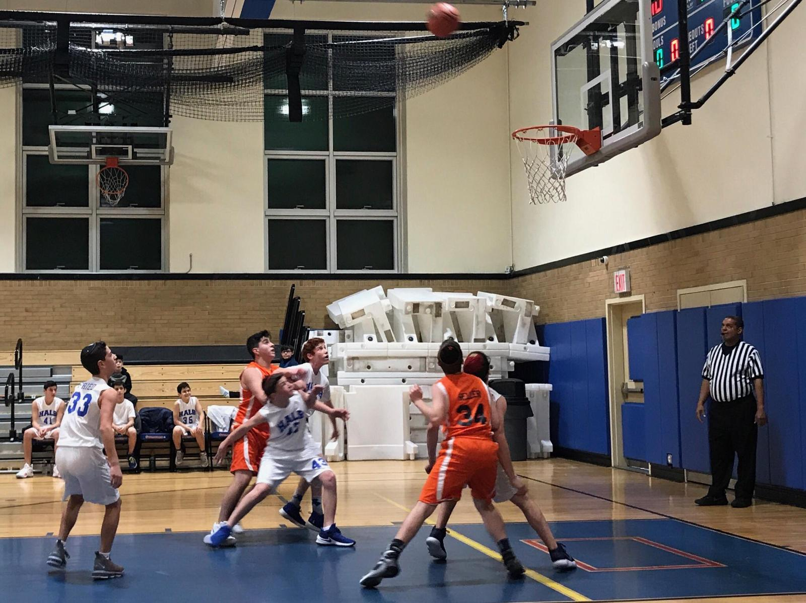 Score! Middle school students compete to shoot hoops and raise donations for IDF soldiers.