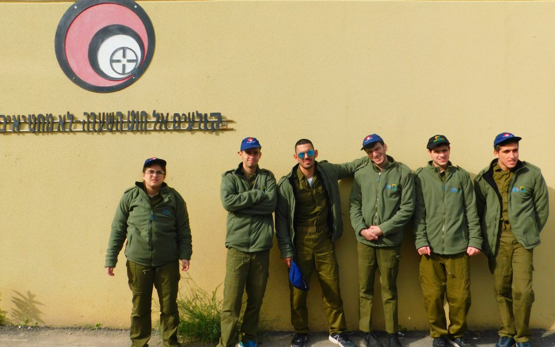 A group of special needs IDF soldiers pose wearing fleeces donated by Yashar LaChayal