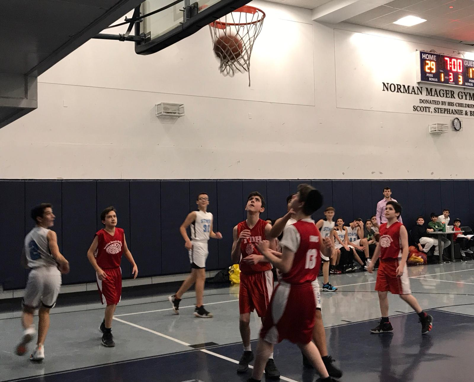 Yeshiva middle school students play basketball