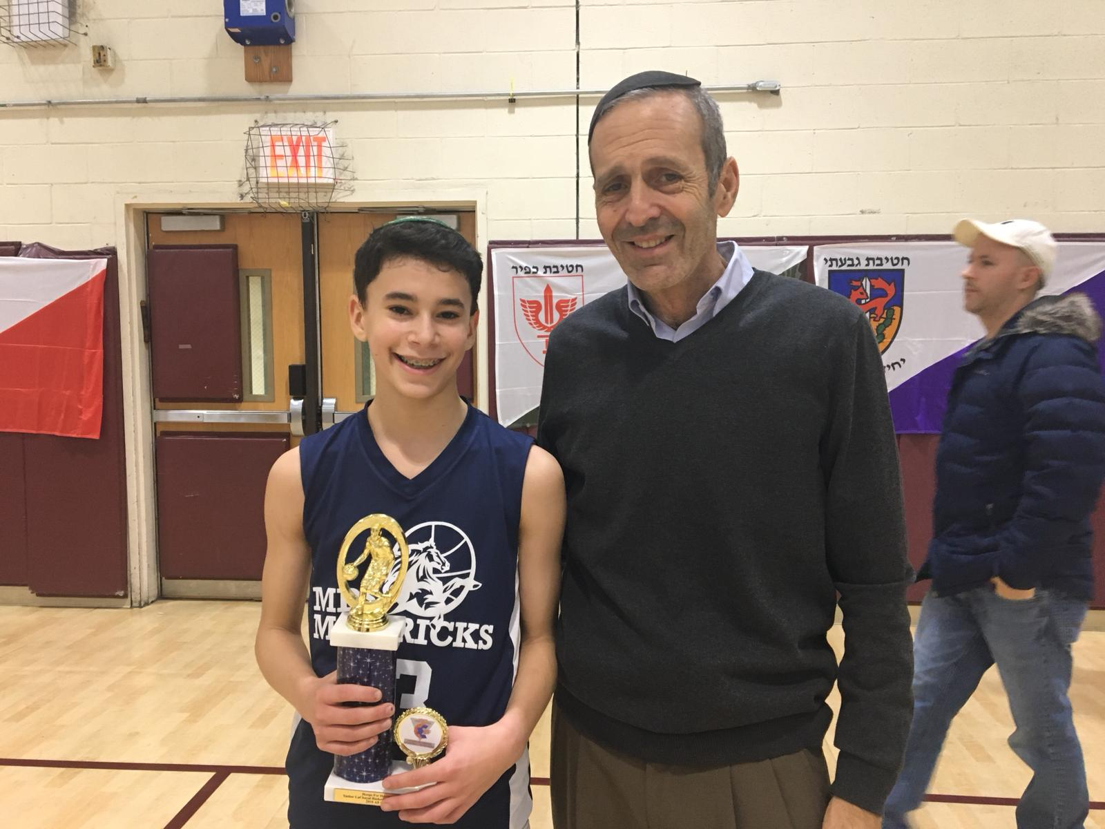 Judah Rhine with the 2018 Basketball champ from Manhattan Day School