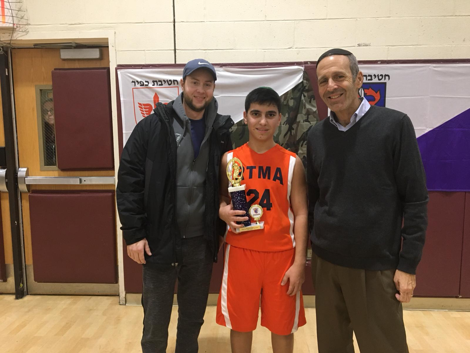 Judah Rhine with the 2018 Basketball champ from the Jewish Educational Center