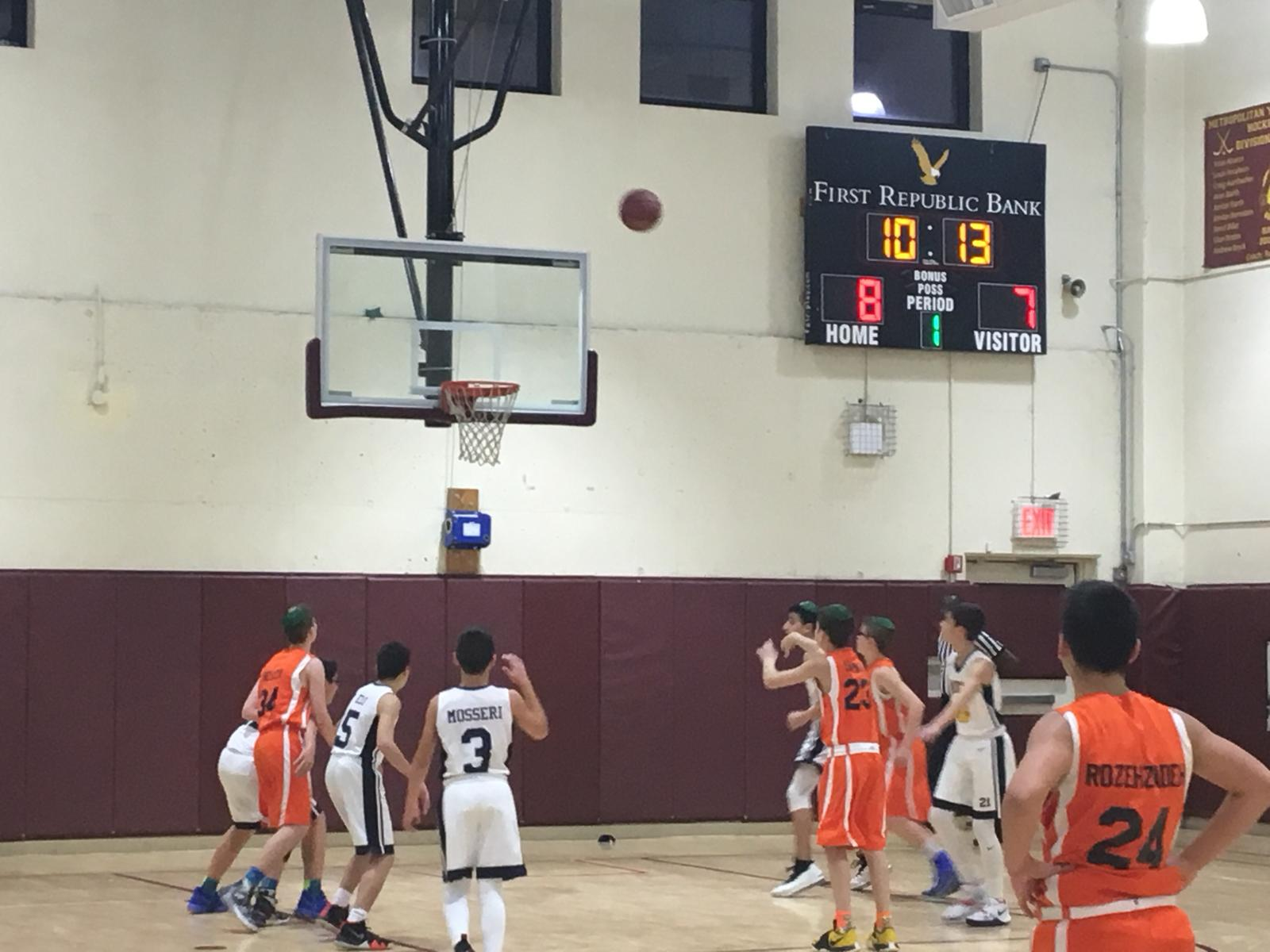 Students from Jewish Educational Center playing basketball against students from Hebrew Academy - Nassau County