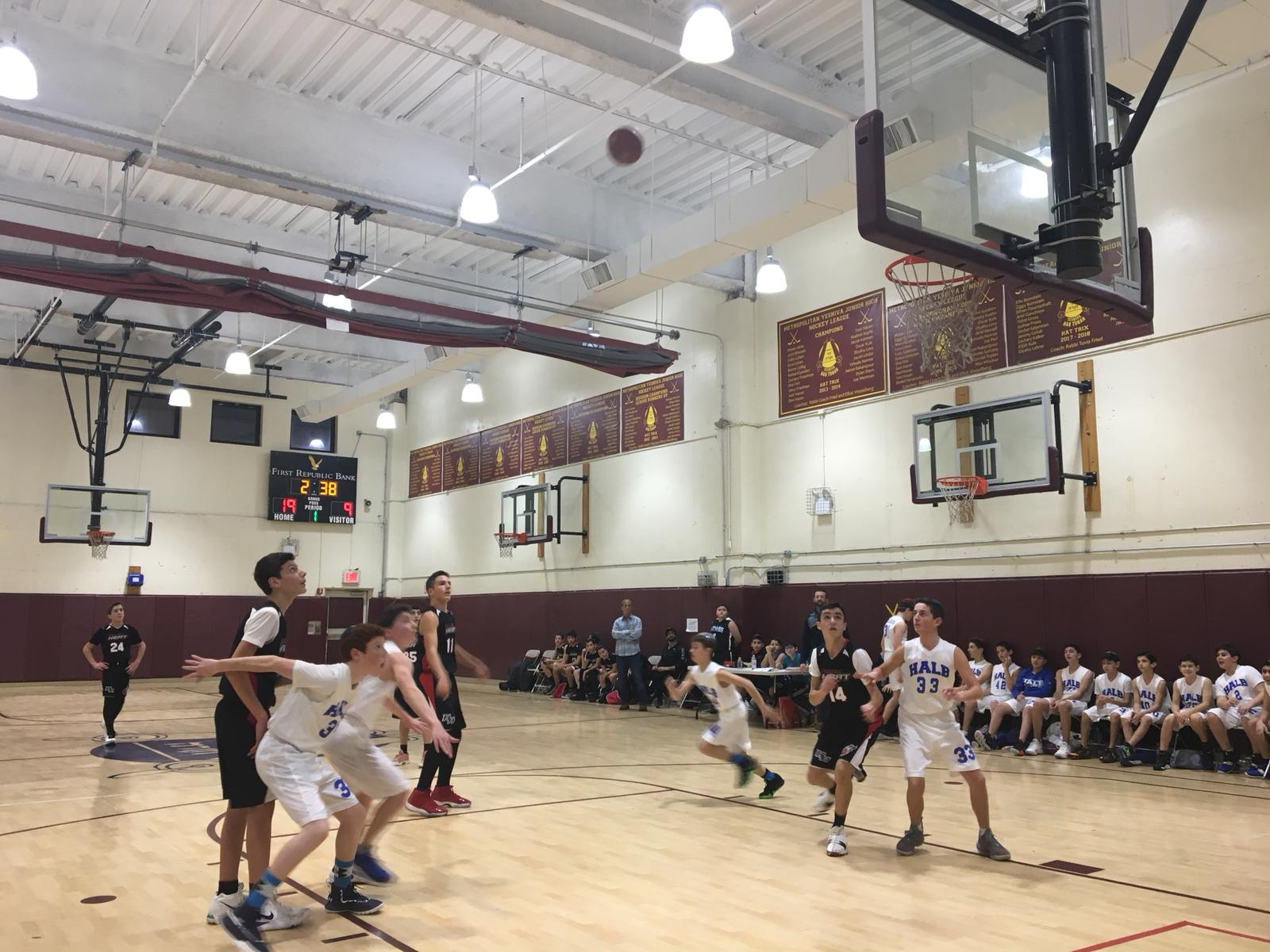 Students from Hebrew Academy of Nassau County play basketball against students from Hillel Yeshiva