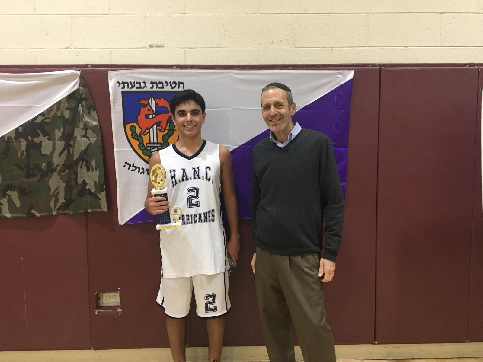 Judah Rhine with the 2018 Basketball champ from the Hebrew Academy - Nassau County