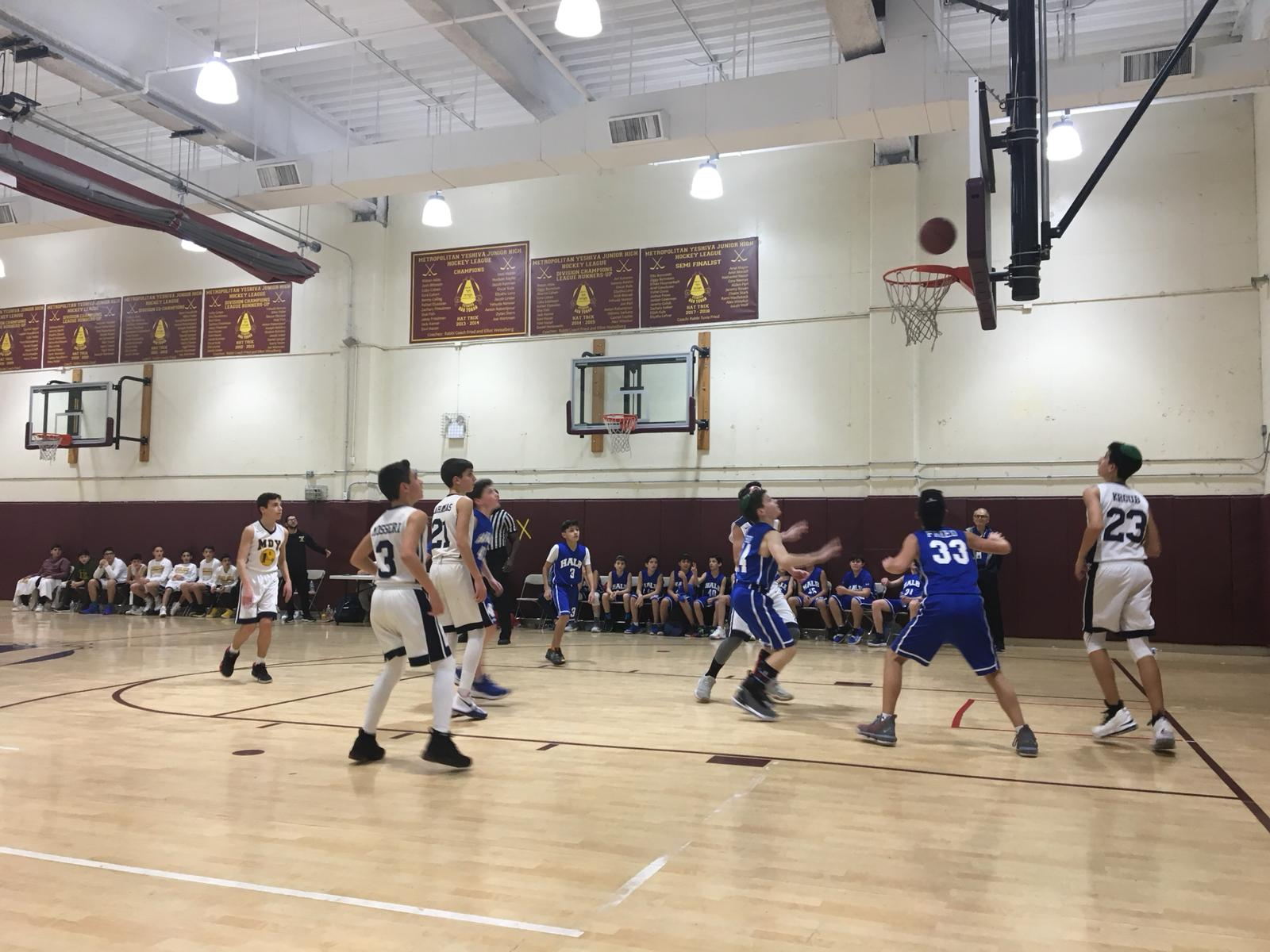 Students from Hebrew Academy of Long Beach play basketball against students from Magen David Yeshiva
