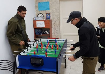 IDF soldiers playing foosball at our Kiryat Arba Warm Corner
