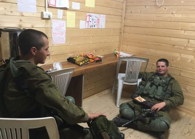 Israeli soldiers relaxing in the warmth of our Warm Corner in Otniel