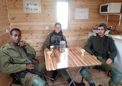 IDF soldiers relax inside our Warm Corner at Ma'aleh Hever