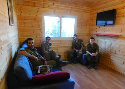 Israeli soldiers relax and lounge in the Warm Corner we built for the IDF in Psagot