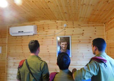 Members of the IDF's Special Forces, who's faces can't be revealed, pay their respects to fallen Israeli soldier Ronen Lubarsky.