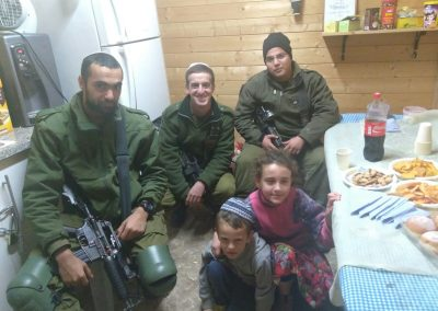IDF soldiers join children from the community of Negohot to celebrate Chanukah.