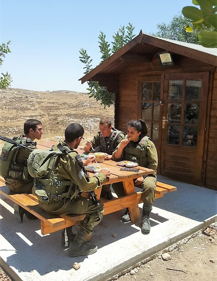 Israeli soldiers enjoying an outdoor snack from our Warm Corner rest station in Otniel
